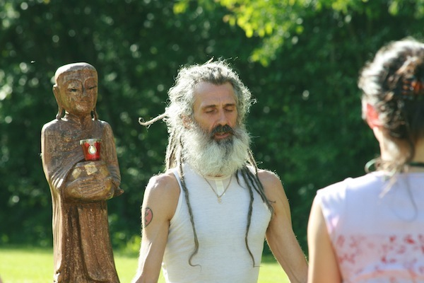 Jivamukti yoga teacher Stuart Gilchrist in the garden at Yeotown