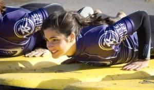 A female surf teacher at Watergate Bay Hotel