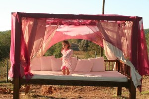 Annoushka on the muslin-shrouded day bed
