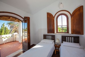 A typical sunny bedroom at Algarve Yoga