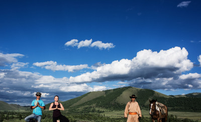 Yoga teacher Emma Henry and the horsemen in Khan Kentii, Mongolia © Richard Pilnick